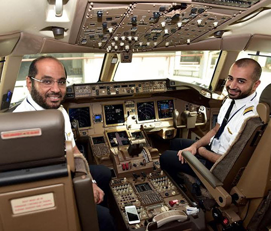 (L to R): Capt. Eisa Al-Hadad and First Officer Yousef Karam preparing for KAC's first B777-300ER commercial flight