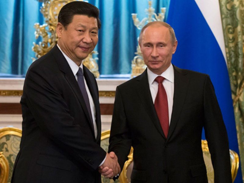 China Vows Stronger Military Ties with Russia