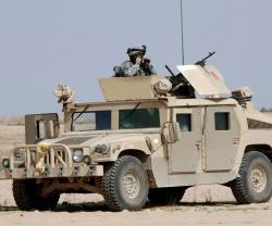 US Delivers 52 Humvees and 1 Patrol Boat to Tunisia